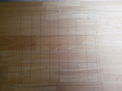 Spend way longer that you though possible drawing a chess board in pencil on the top. Make a few mistakes in measuring, after all that's why you used pencil right?